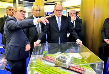 HSH Prince Albert II took time to tour the dozens of stands and industrial exhibits of MIIFED-IBF 2016. He is pictured here listening to the explanations provided by ITER Director-General Bernard Bigot and Pierre-Marie Delplanque, from Agence Iter France, on the transport of ITER's largest components. (Click to view larger version...)