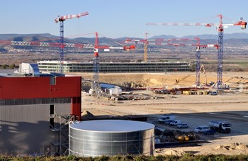 The three projects that transformed the ITER platform in 2011: the Poloidal Field Coils Winding Facility (foreground) which will be ''signed and delivered'' during the first weeks of January; the excavation of the Tokamak Pit and ongoing foundation works; and—in the distance—the ITER Headquarters. (Click to view larger version...)