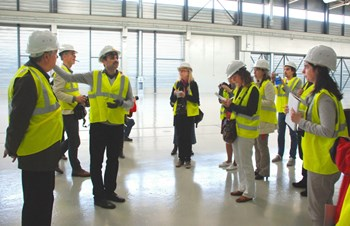 The two-day program included a visit of the worksite and presentations on the status of the project, plasma physics, tritium cycle, etc. Here, civil engineer Mahaboob Basha Syed gives a tour of the Poloidal Field Coils Winding Facility. (Click to view larger version...)