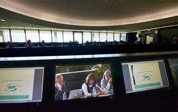 Following the ASN presentation, acting division head for Nuclear Safety, Licensing & Environmental Protection Joëlle Elbez-Uzan, (center, on the video screen) answered the questions from the public. (Click to view larger version...)