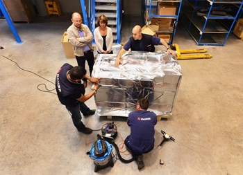ITER Coil Instrumentation engineer Felix Rodriguez-Mateos and DAHER's Ines Bollini (left) watch as dozens of components are being taped, wrapped into thick heat/humidity insulation aluminium foil and placed into a robust wooden crate. (Click to view larger version...)