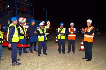 The convoy arrived on the ITER site at 5:25 a.m. Standing with ITER Director-General Motojima (far right) are members of the DAHER team, including the last-stage driver Karl Kilian (blue jacket); François Genevey, chief of ITER Project at DAHER (third from right) and Bernard Bon, head of convoy (second from right). (Click to view larger version...)