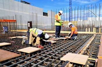Embedded plates are inserted into the rebar lattice prior to pouring concrete. Each plate is positioned in accordance with the 3D Configuration Management Model and tuned with a theodolite in order to be level with the future concrete surface. (Click to view larger version...)