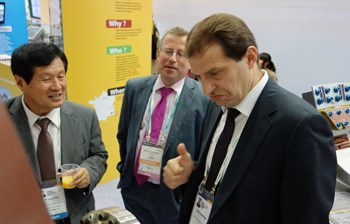 A delegate from the Turkish Ministry of Energy and Natural Resources is clearly impressed by the blanket module mockup on show at the ITER stand. Standing nearby are (left) Kijung Jung, head of ITER Korea, and Michel Claessens, Head of ITER Communication & External Relations. (Click to view larger version...)