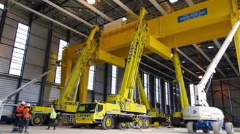The crane stands 18 metres high and travel on rails fixed to the floor, in order to cover the entire length of the workshop during the assembly process. (Click to view larger version...)