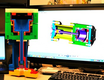 A 3D printed version of a fast gas valve for the disruption mitigation system. The 3D design is shown on the computer screen in the background. Photo: US ITER (Click to view larger version...)