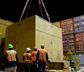 The 800-metre sample toroidal field conductor was transferred to a container ship at the port of Charleston, South Carolina, on 28 May for its voyage to the European winding facility in La Spezia, Italy. Photo: US ITER (Click to view larger version...)