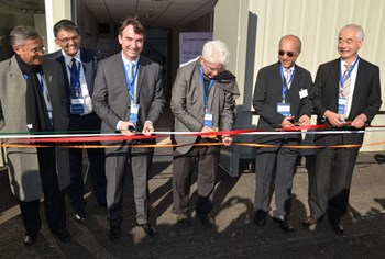 The symbolic ribbon at the entrance of the Cryostat Workshop was cut by Benoît Moncade, director-general of Spie-Batignolles; Pr. Predhiman Krishan Kaw, Indian delegate to the ITER Council; M.V. Kotwal, president of Larsen & Toubro's Heavy Engineering Division; and Osamu Motojima, Director-General of the ITER Organization. Looking on are Dhiraj Bora, director of the Indian Institute of Plasma Research and former ITER DDG and Ganesh Iyer, head of the ITER Project at Larsen & Toubro Ltd. (Click to view larger version...)