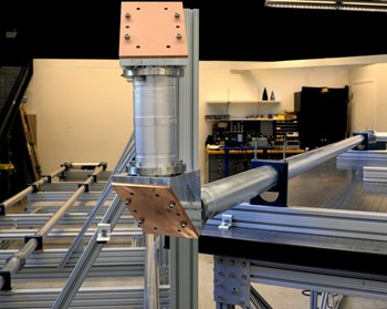 A test stand for the low-field-side reflectometer at UCLA mimics an ITER-like waveguide route; the copper material is part of a 30 degree miter bend. ORNL designed and fabricated the waveguide. Photo: UCLA (Click to view larger version...)