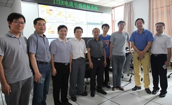 Assembled in the test hall control room at ASIPP (from left to right): ASIPP's Feng Hansheng, Chen Junling, Song Yuntao and Wan Baonian; the head of the Chinese Domestic Agency (CNDA), Luo Delong; ASIPP's Ding Kaizhong (test leader), Zhou Tingzhi (lead manufacturing responsible officer), Li Jiangang; and CNDA's He Kaihui. In the back, the MIMIC screen of the test control system supplied by the ITER Organization. (Click to view larger version...)