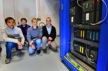 Bin Li, Carlos Fernandez Robles, Jean-Marc Fourneron and Pierre Petitpas from the Plant Control & Instrumentation Section are pictured next to an example of the Siemens S7 400 F/FH range of programmable controllers that has been certified for ITER. (Click to view larger version...)