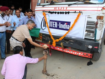 Dhiraj Bora, director of the Institute for Plasma Research, performs the traditional coconut-breaking ceremony at the departure of the nine-truck convoy. Also present were ITER India director Shishir Deshpande, Project Manager Ujjwal Baruah, Deputy Project Manager Narinder Singh and General Manager Brig. Umar Farook from prime contractor ECIL. (Click to view larger version...)