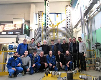Representatives of the ICAS consortium and the European Domestic Agency celebrate an important milestone for ITER magnets—Europe's successful completion of 20 km of toroidal field conductor. (Click to view larger version...)