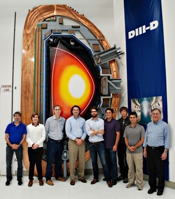Real-time error field correction was demonstrated by a multi-institutional research team that included scientists from General Atomics, Oak Ridge Associated Universities, the University of California-San Diego, and Columbia University. Note the ''X point'' in the upper part of the D-shaped plasma in the background poster: DIII-D is one of the few tomakaks that can be operated with upper, lower or multiple ''X points.'' (Click to view larger version...)