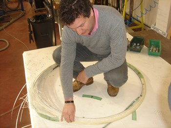 At the Italian laboratory ENEA, Juan assesses the failure mode of one of the ten mock-up rings tested to rupture. (Click to view larger version...)