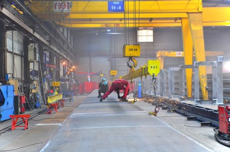 In addition to the main system that will lift loads of up to 1,500 tonnes, REEL will also deliver an auxiliary 50-tonne overhead crane, which is currently in the fabrication stage. (Click to view larger version...)