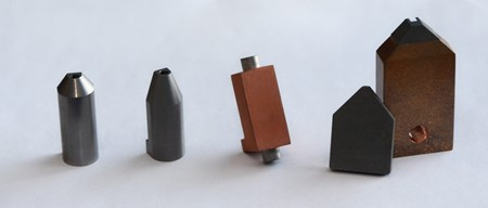 The heatshield design has evolved over the years. from right to left: May 2014; December 2017; March 2018; September 2018. (Click to view larger version...)