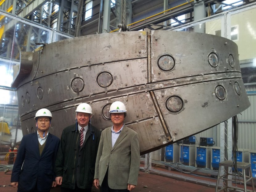 At Hyundai Heavy Industries, Alexander Alekseev, head of ITER's Tokamak Directorate (centre), stands with Technical Responsible Officers Hee-Jae Ahn (Korea, left) and Chang-Ho Choi (ITER Organization, right) in front of the upper segment of full-scale mockup for the ITER vacuum vessel. (Click to view larger version...)