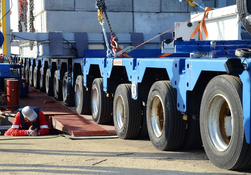 Personnel from ITER logistics provider DAHER and the Compagnie Fluviale de Transport monitored every millimetre of progress as the trailer crossed onto the barge. (Click to view larger version...)