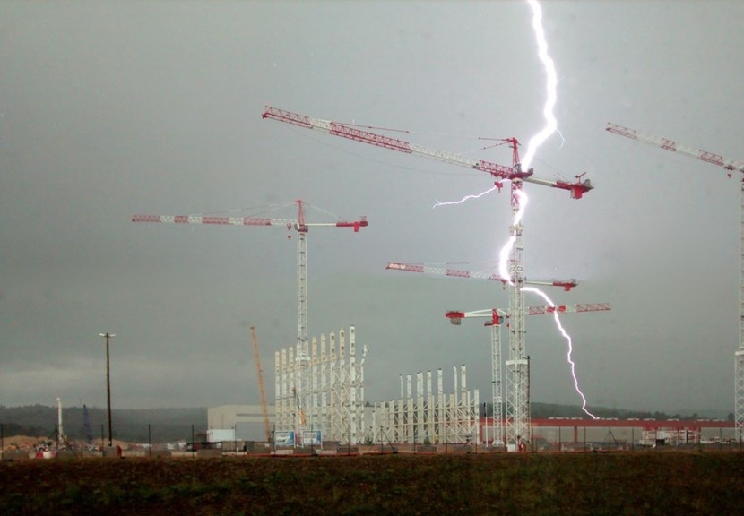 At 3:37 p.m. on Tuesday 9 June, a monster bolt hit crane #2. In his cabin, veteran operator M'hamed Harit said it felt like being ''caught between bombs and a mega fireworks display.'' Graeme Vine, from the ITER vacuum team, took this exceptionally well-timed picture from his third floor office. (Click to view larger version...)