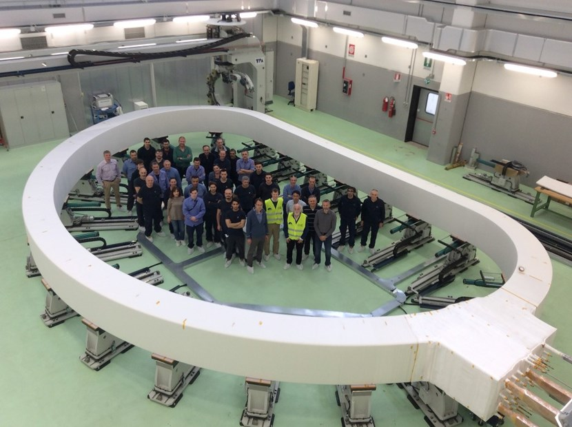 A giant magnet ... and a giant step forward for ITER. Representatives from the European Domestic Agency, the ITER Organization and contractors stand inside of the first inner winding pack of an ITER toroidal field coil. (Click to view larger version...)