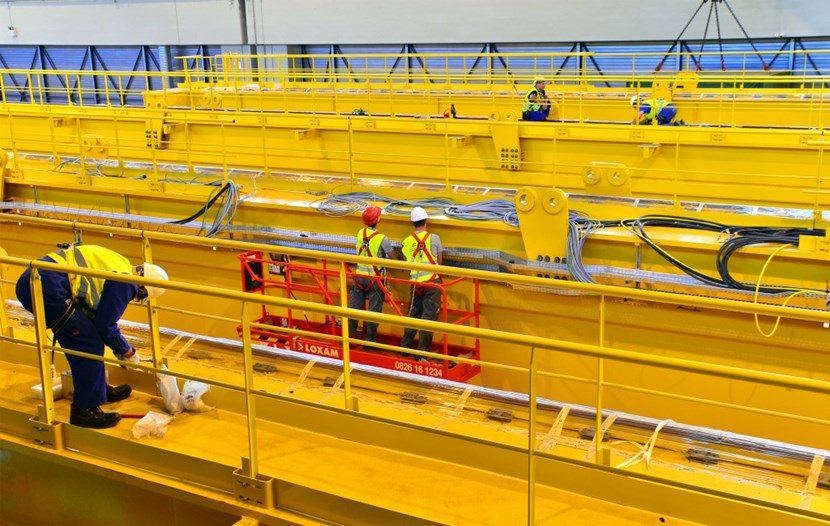 In the Poloidal Field Coils Winding Facility workers are busy installing the accessories and electrical equipement of the four 155-tonne girders that will form the Assembly Hall's double overhead travelling crane. (Click to view larger version...)