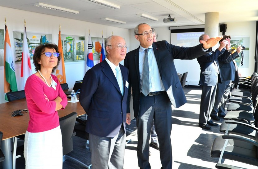 The ITER Director-General's office, on the fifth floor of the Headquarters Building, offers a striking view of the construction site. From left to right, Anne Lazar-Sury, French governor at IAEA, IAEA Director General Amano, ITER Director-General Bigot, and Jean-Louis Falconi, French ambassador to the IAEA. (Click to view larger version...)