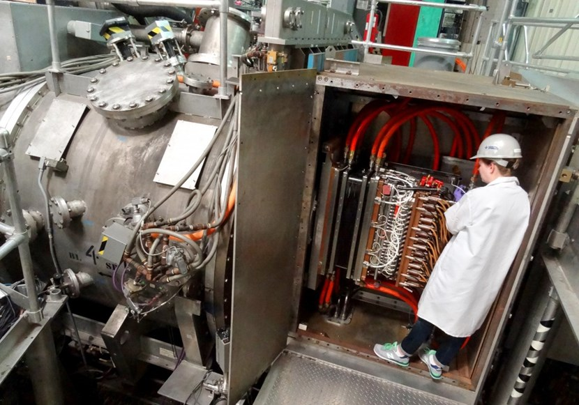 Ashley Harris from the Neutral Beam Team at General Atomics works on the system that injects 20 MW of power into the DIII-D tokamak ... or the equivalent of the power used in approximately 15,000 homes. Photo: GA (Click to view larger version...)