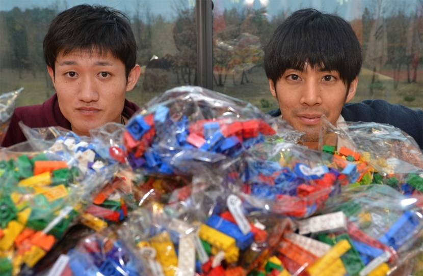 Taishi Sugiyama (left) and Kaishi Sakane from Kyoto University have invested the lobby of ITER Headquarters for one week. Their challenge? To assemble 40,000 Lego bricks into a model of the ITER Tokamak. (Click to view larger version...)