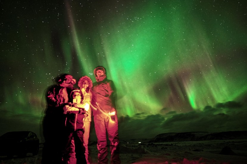 Sébastien and his family in Iceland, under the thin, luminescent drapes of Iceland's Northern Lights—''an incredibly moving experience...'' (Click to view larger version...)