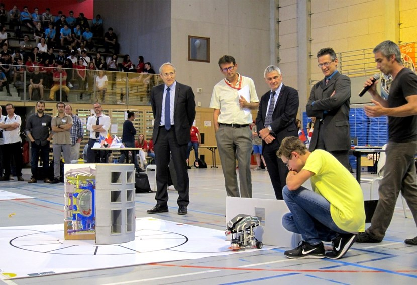 ITER Director-General Bernard Bigot (far left) looks on at one of the day's many white-knuckle moments. Months of planning, teamwork, and ingenuity came together on 23 May, at the sixth edition of ITER Robots. (Click to view larger version...)