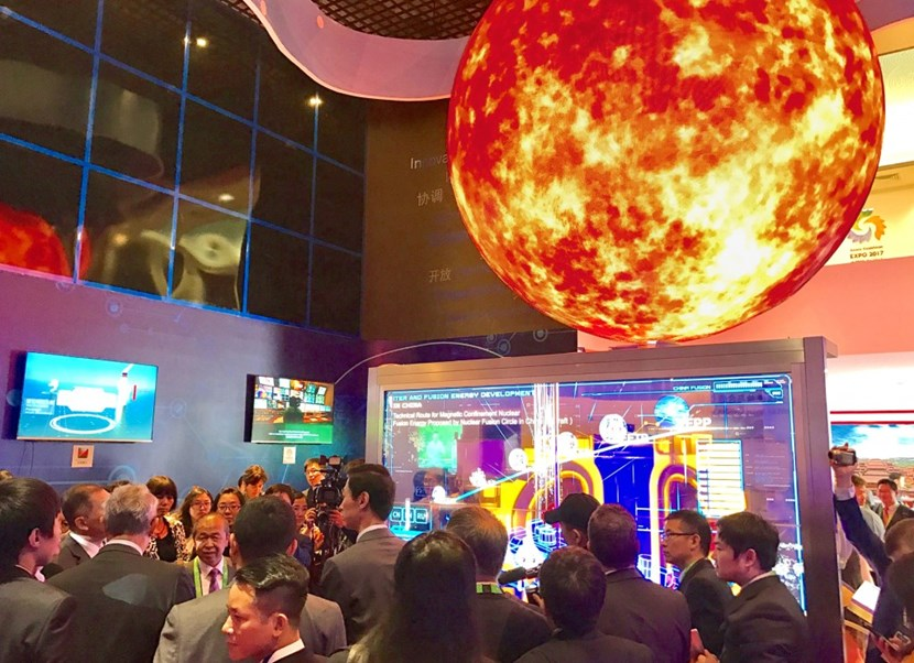 The opening of the Chinese Pavilion drew an enthusiastic crowd eager to learn about fusion. A holographic model of the ITER Tokamak was one of the highlights. (Click to view larger version...)