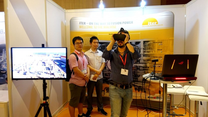 Like you were there! At the ITER stand, these students are trying out the Oculus Rift virtual reality system that makes you feel like you are hovering over the ITER construction site. (Click to view larger version...)