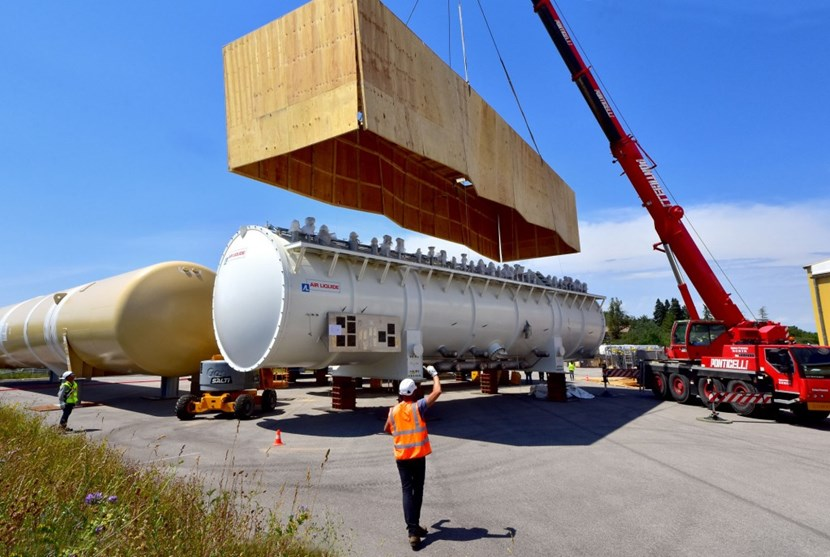 A ''box-opening'' operation took place last week at the entrance of the ITER site where large components are stored. Three large elements of the liquid helium plant (''cold boxes'') were uncovered to prepare for their transport and installation in the ITER cryoplant. (Click to view larger version...)