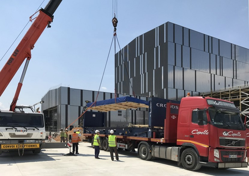 The first components of the sector sub-assembly tool have reached ITER; four more batches are planned in the coming months. The 90 crates of material will be stored in the Cleaning Facility (the smaller building in the photo) until tool assembly begins. (Click to view larger version...)