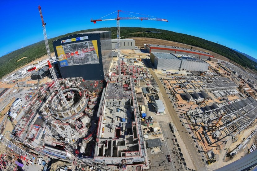 Little free space remains on the 42 hectares (100 acres) of the ITER scientific platform. Sandwiched between the cooling tower zone and concrete batching plant at the northern end (far left) and the electrical switchyard to the south (far right) are the work areas for the Tokamak Complex (centre crane), the cryoplant (middle right, all grey) and the buildings for magnet power conversion (twin structures, right). Any free space is used for storage. At the top of the image, manufacturing is underway in on-site facilities for the cryostat and one of the magnet systems, the poloidal field coils. (Click to view larger version...)