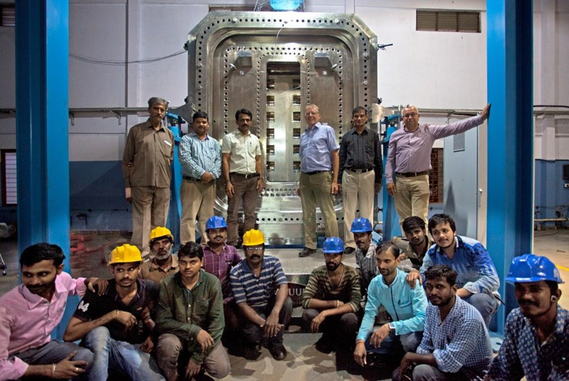 The team in celebratory mood after the completion of the test rig. This full-size replica of the largest of the equatorial ports has been designed to test the vacuum sealing. (Click to view larger version...)