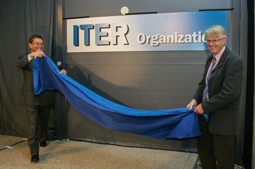Director-General Nominee Kaname Ikeda (left) and his second-in-command Norbert Holtkamp unveil the ITER Organization plaque at the entrance of the prefabricated building that already accommodated 170 ''ITER people.'' (Click to view larger version...)