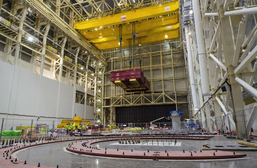 High in the rafters, the trolley's electrical motors are pulling with all their strength at the cables holding the dummy load, 10 percent heavier than the nominal lifting capacity (1,500 tonnes) of the massive double overhead crane. (Click to view larger version...)