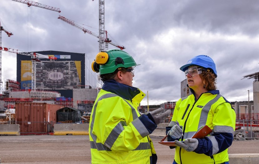 Angie Jones (right) regularly meets with colleages on the worksite to see progress and problems firsthand. Here, she gets briefed by her health and safety manager, Leanne Dargacz. (Click to view larger version...)