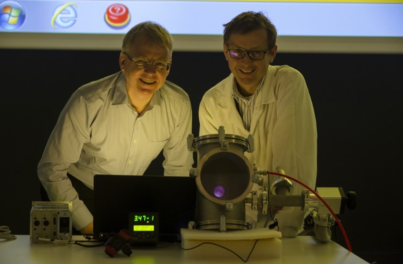 Close to eight years ahead of schedule, ITER's First Plasma was produced last week in the Headquarters amphitheatre ... Pictured here: Vacuum Section leader Robert Pearce (left) and Silvio Giors. (Click to view larger version...)