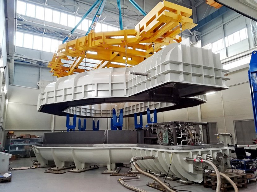 The first toroidal field winding pack (110 tonnes) fabricated in Europe is lowered into a specially designed cryostat for cold testing. © SIMIC (Click to view larger version...)