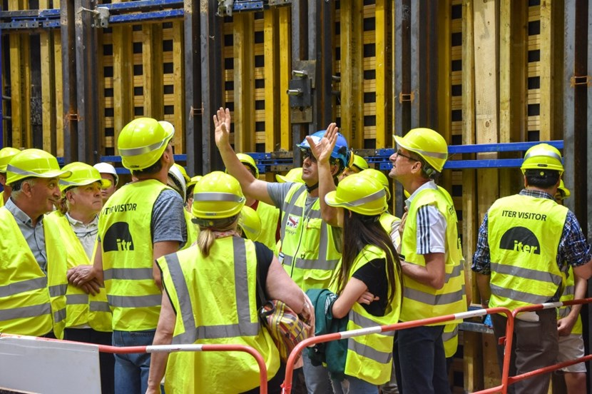 Vincenzo Sarica, from European contractor Engage, was one of the 50 volunteers on hand to tell the ITER story. In this case, he is directing gazes upward as he describes the 30-metre-tall ''well'' that was built to house the ITER machine. (Click to view larger version...)