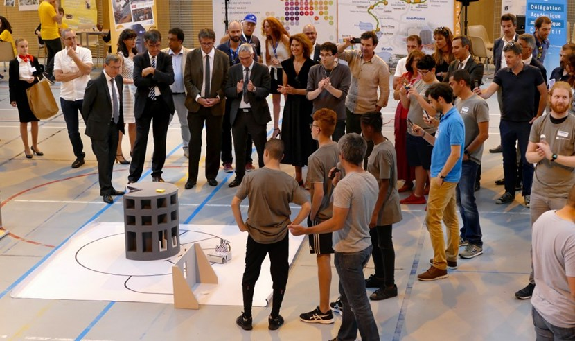 ITER supporters applaud the successful robot in a Transport challenge demonstration. (Click to view larger version...)