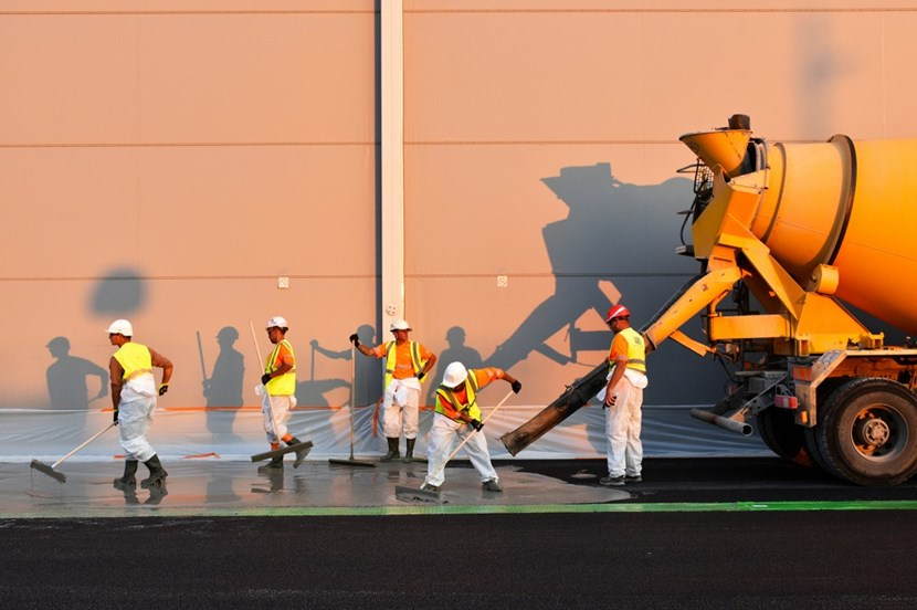 Workers of the French company Colas finalize the surfacing by spreading concrete grout. The work was carried out under the responsibility of Fusion for Energy (F4E), the European Domestic Agency, and supervised by Engage, F4E's architect-engineer contractor. (Click to view larger version...)