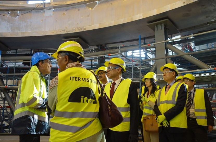 At the end of the second day, the ITER Director-General proposed a visit on site. One group of delegates can be seen here standing on the floor of the cryostat base, with the rim of the base in the background. (Click to view larger version...)