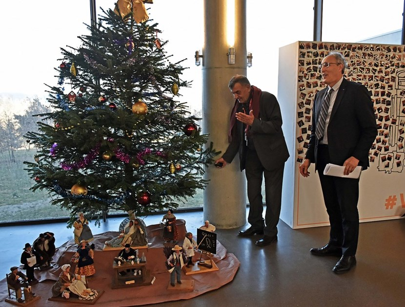 Roger Pizot (left), the mayor of Saint-Paul-Lez-Durance, lights the Christmas tree he traditionally gifts to ITER. Look closely for the ITER scientist to the right of the nativity scene. (Click to view larger version...)