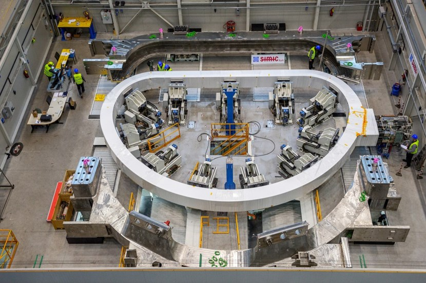 European contractors perform the first insertion operation of toroidal field coil manufacturing. The completed unit—winding pack plus case—weighs approximately 310 tonnes. © SIMIC (Click to view larger version...)