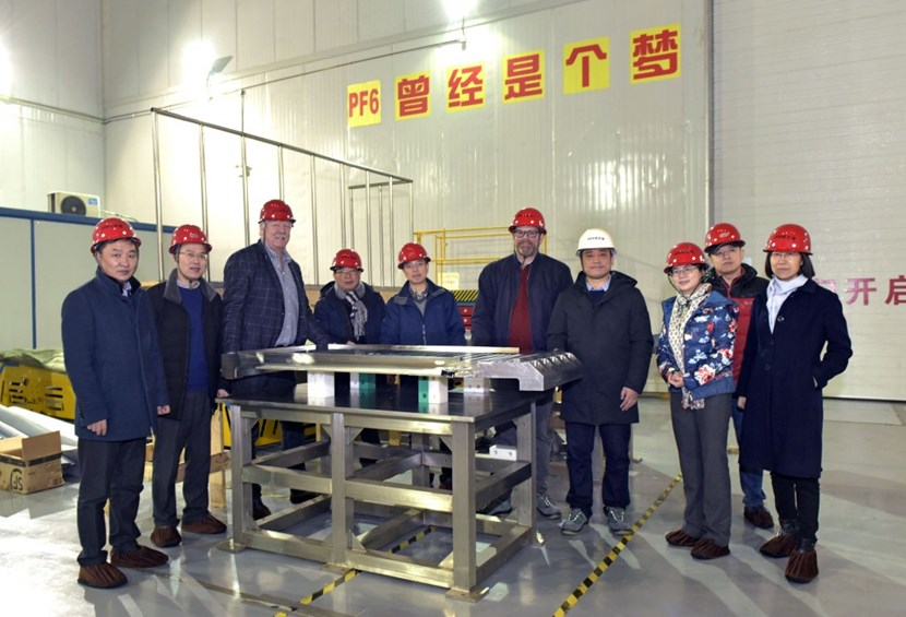 In Hefei, the first set of clamping plates for PF6 were handed over to the European Domestic Agency (F4E). (Click to view larger version...)