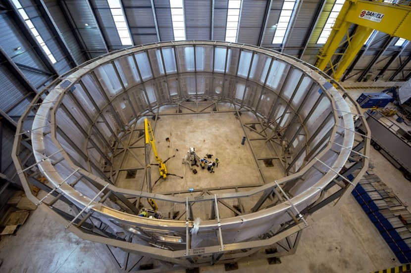 Operators in the centre provide a sense of scale. The cryostat lower cylindre is more than 10 metres tall and approximately 30 metres in diameter. And it represents only one out of four sections ... (Click to view larger version...)
